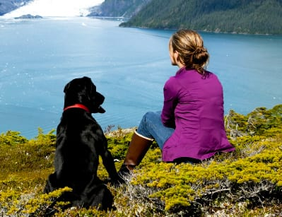 Woman sitting with Labrador photo